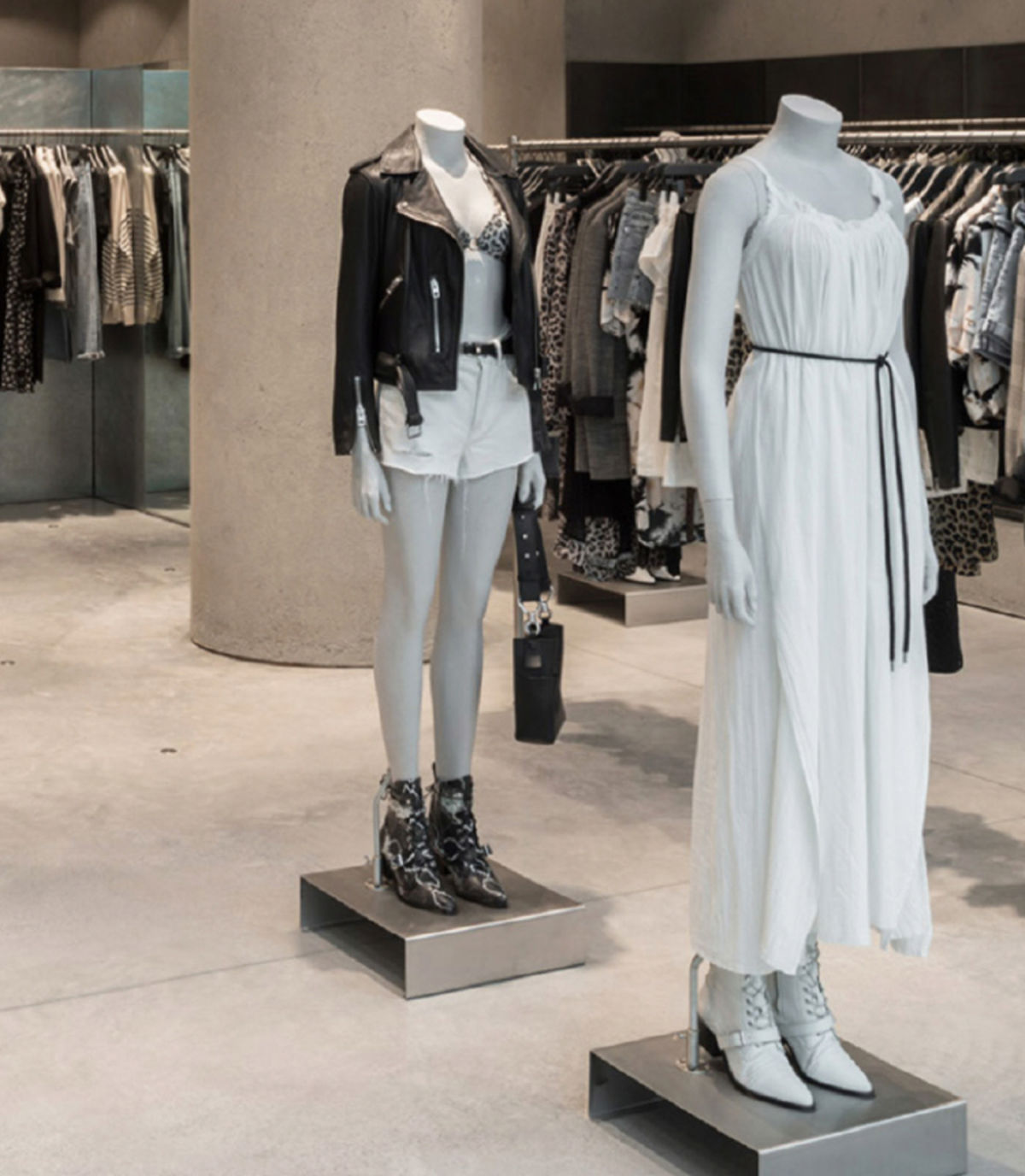Two mannequins inside a store wearing items from our women's collection.