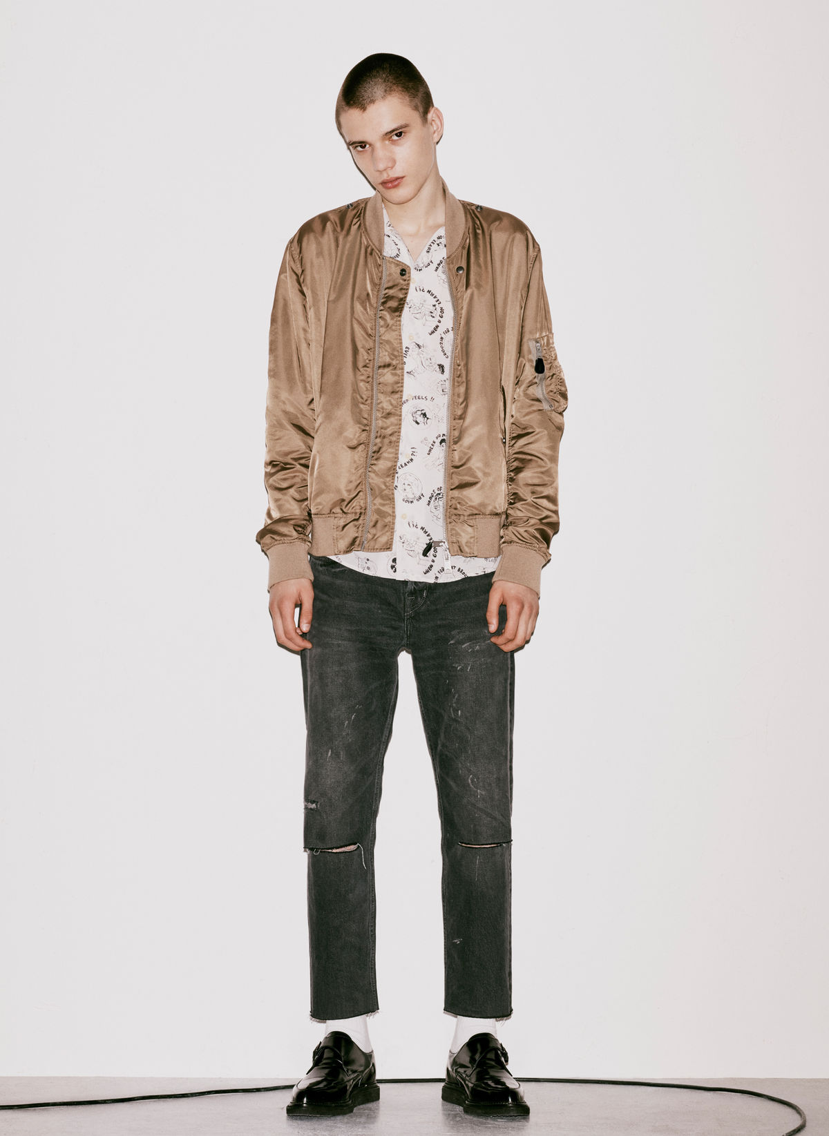 Lookbook image of a man standing in front of a plain white background and wearing an outfit option from our August new arrivals.