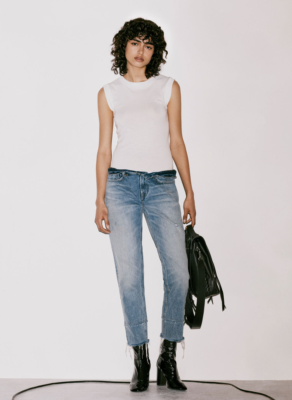 Lookbook image of a woman standing in front of a plain white background and wearing an outfit option from our August new arrivals.