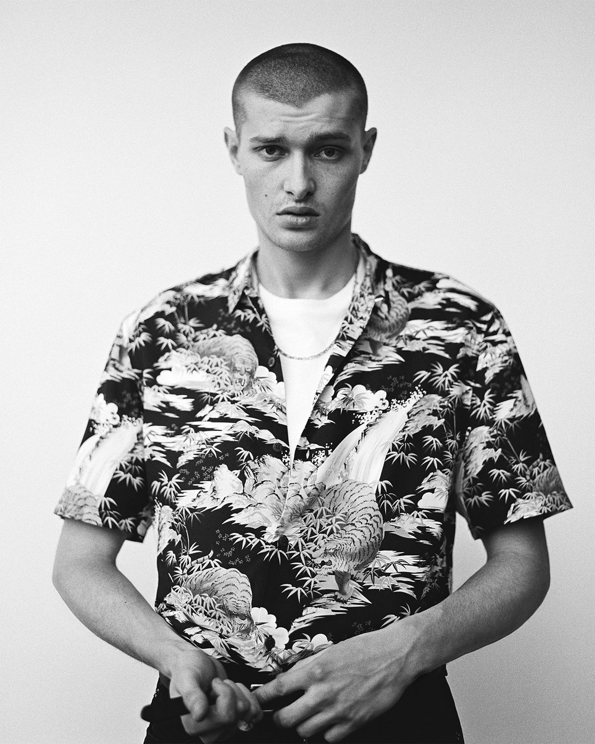 Campaign image of a man wearing one of our Hawaiian shirts.
