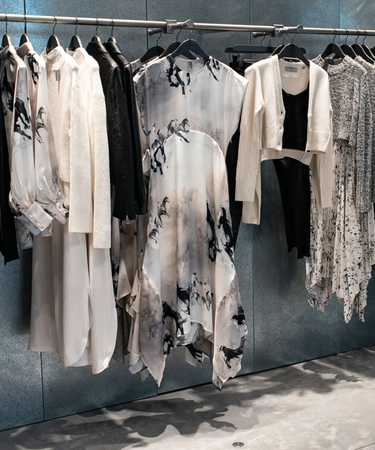 Pieces from our new Spring collection hanging on the shop floor.