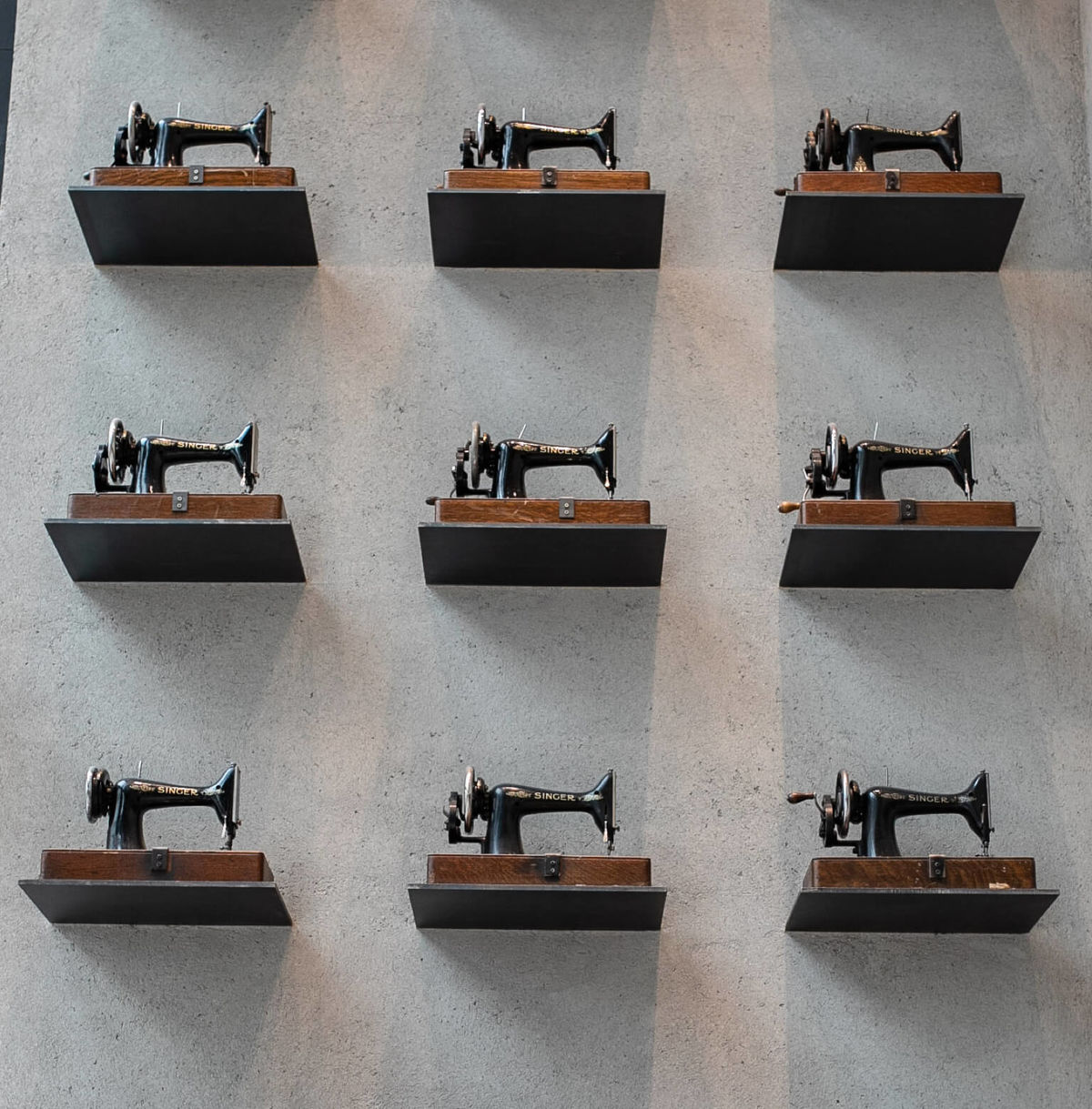 A wall in one of our store displaying our iconic sewing machines.