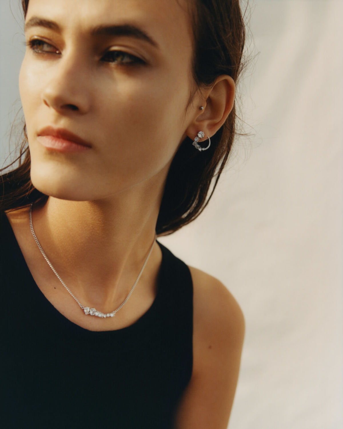 Portrait of a woman wearing a necklace and earings from our jewellery collection.
