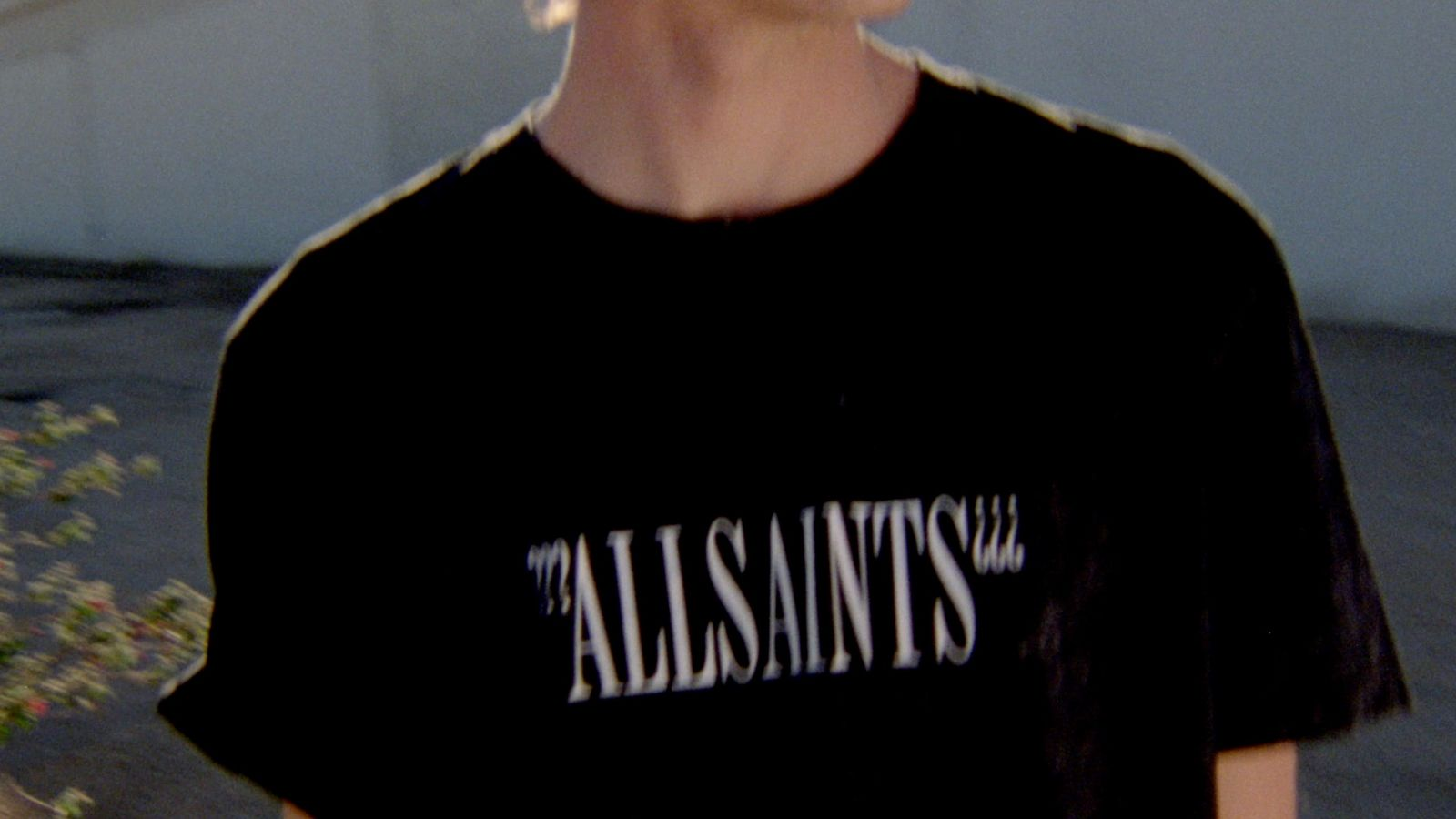 Mini-clip screenshot of a man wearing a black t-shirt with a white logo accross the chest from out latest collection.