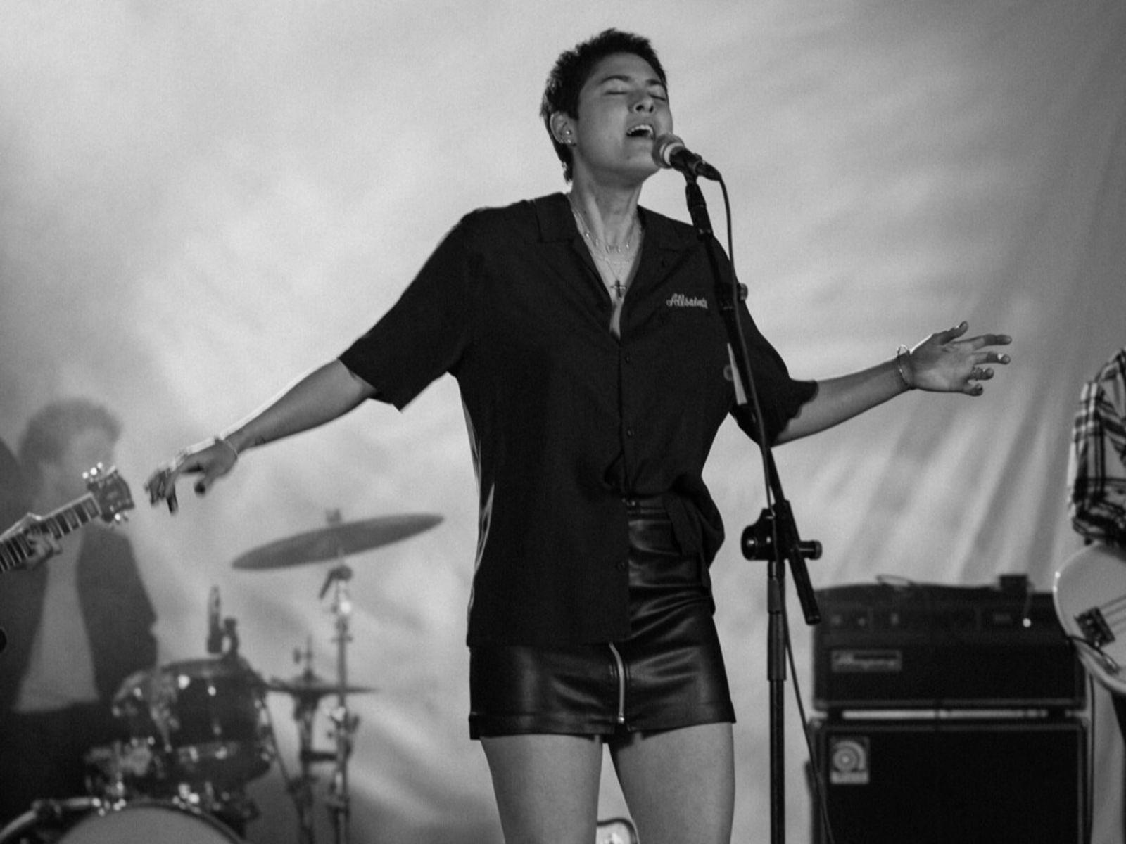 Black and white image of Miya Folick singing.