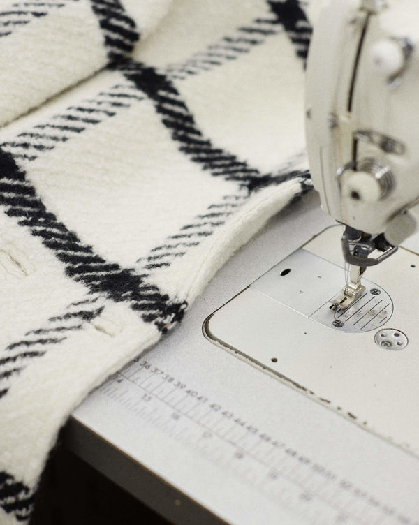 Checked fabric on a sewing machine.