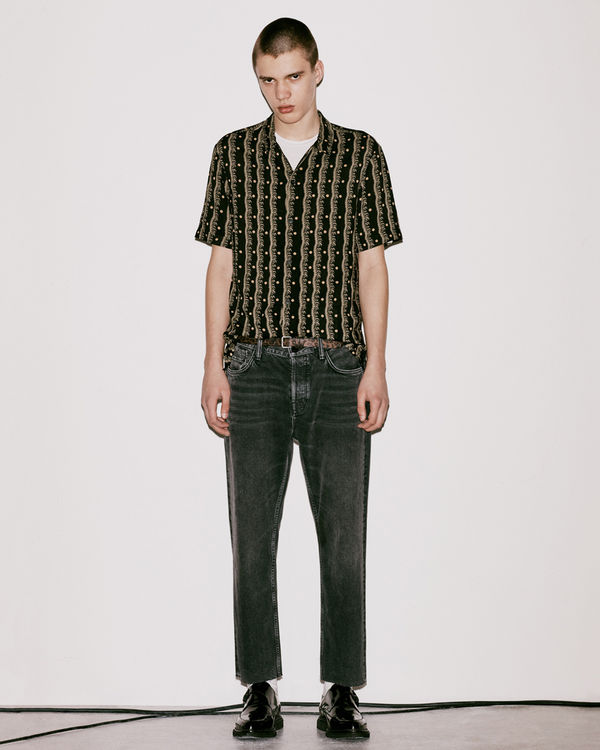 Lookbook image of a man wearing a shirt from the latest collection