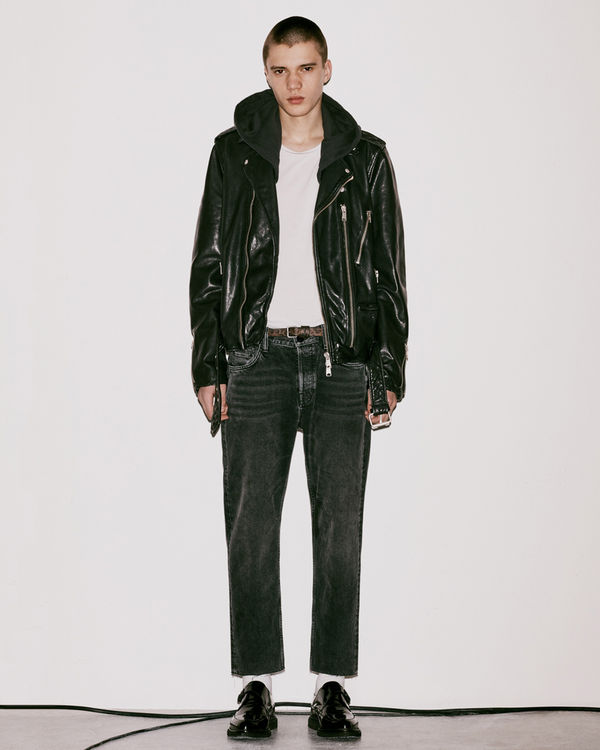 Lookbook image of a man wearing a leather jacket from the latest collection