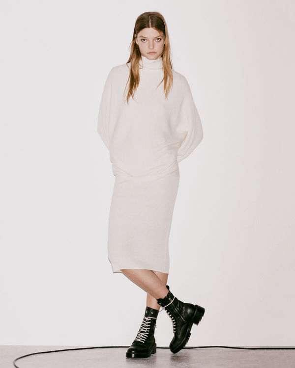Lookbook image of a woman wearing a knitted piece from the latest collection