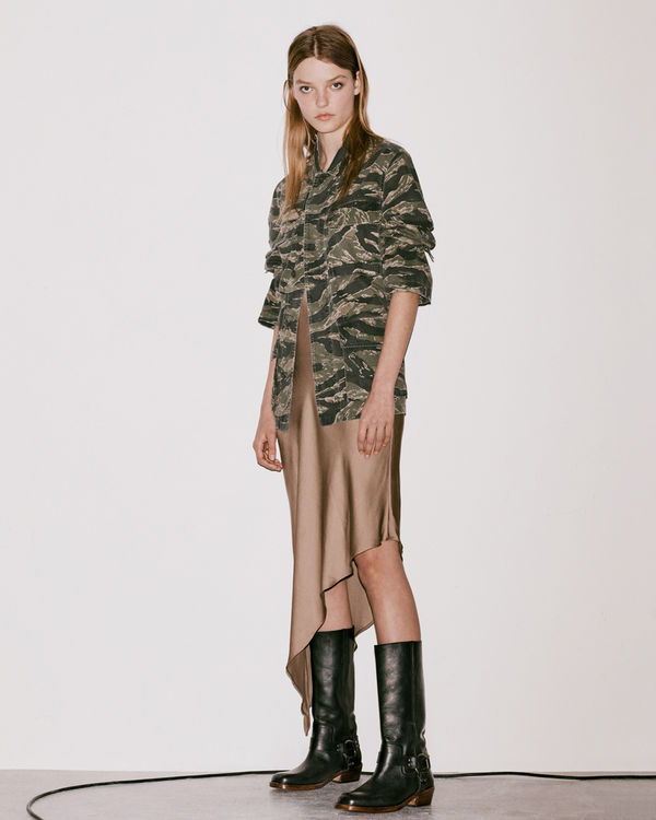 Lookbook image of a woman wearing a silk dress from the latest collection