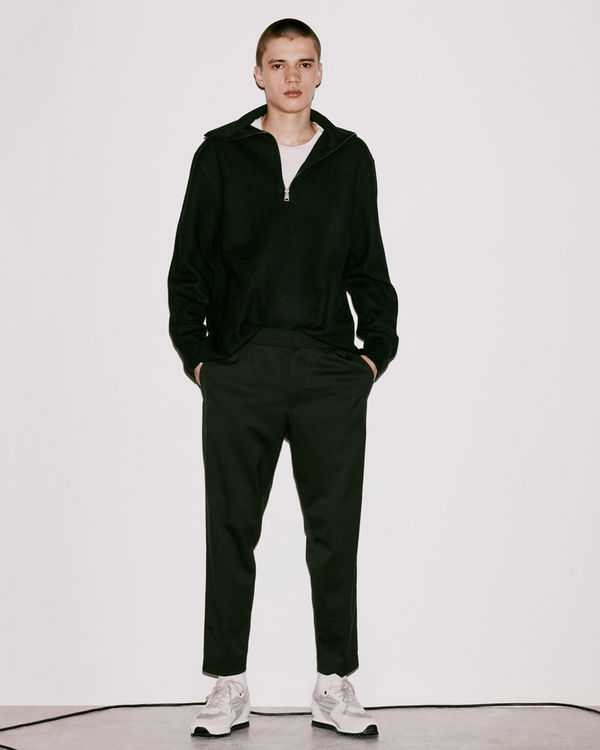 Lookbook image of a man wearing the latest collection.
