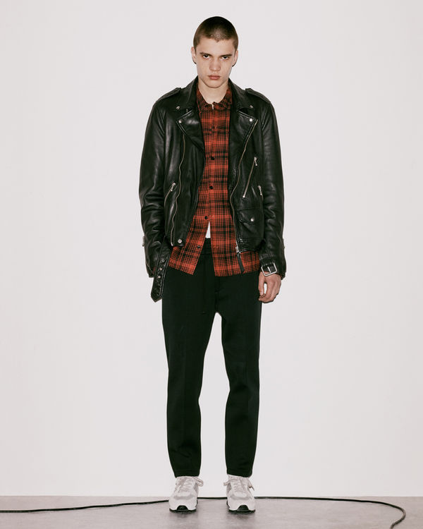 Lookbook image of a man wearing a leather jacket from the latest collection.