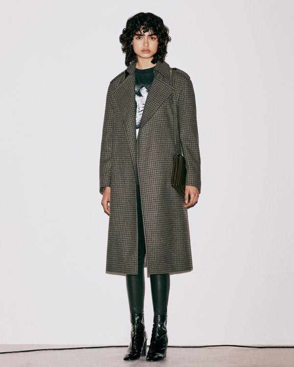 Lookbook image of a woman wearing a coat from the latest collection.