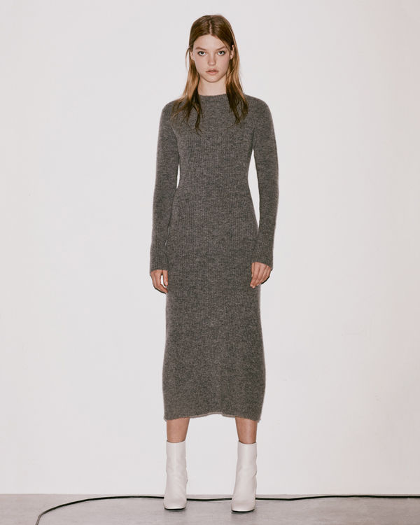 Lookbook image of a woman wearing a knitted dress from the latest collection.