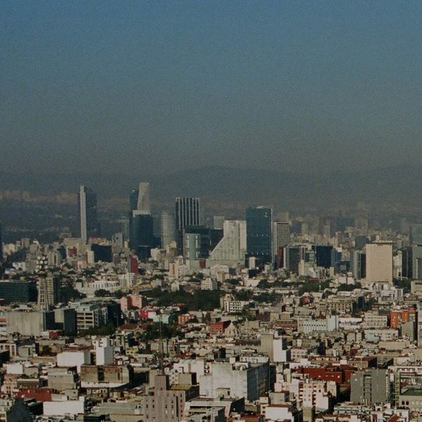 Sale messaging with a background image of Mexico City shot from the sky.