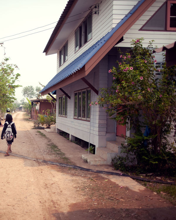 Photography of the dirt path next to the Not For Sale house in Thailand.