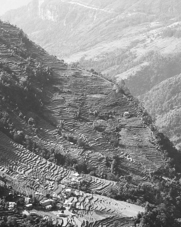 Black and White photo of village situated on the side of a mountain in Thailand.