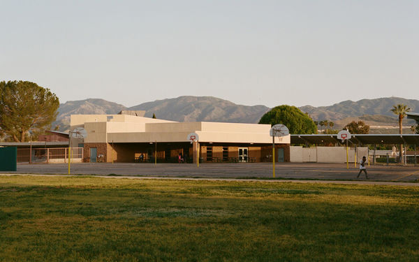 Photo of an American school with hills in the background