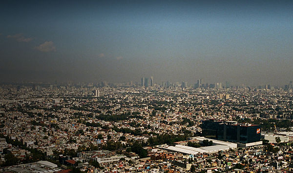 Photo of the skyline of Mexico taken from a helicopter with the title I Love Mexico City written in yellow.