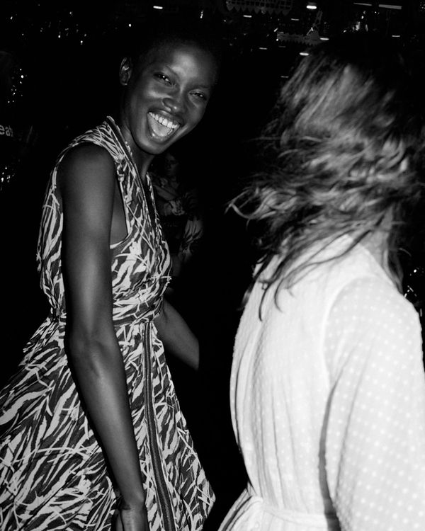 Black and white campaign image of 2 women partying and wearing dresses from our lastest collection.