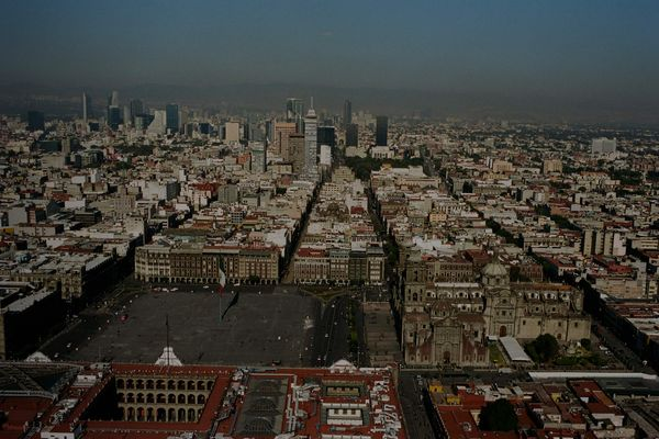 Sale messaging and category links with a background image of Mexico City shot from the sky.