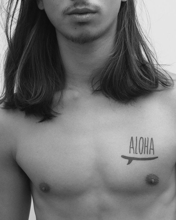 Close-up on a man's chest showing his Aloha tattoo.