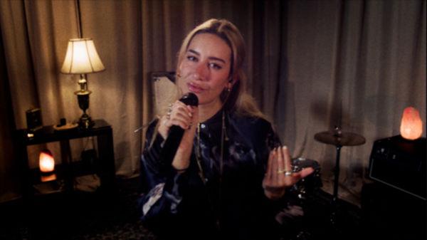 Close up shot of Julia Wolf singing.