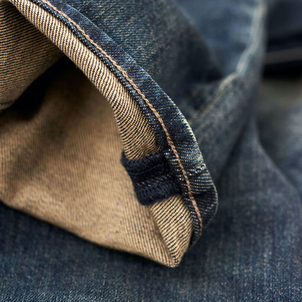 Close up on one of our jeans' hem.