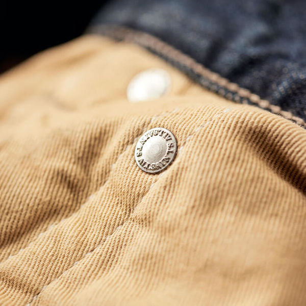 Close up of the hidden rivet on the inside of the jeans