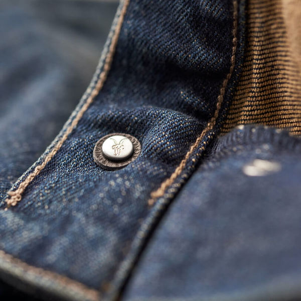 Close up of the leather piece at the back of a button.