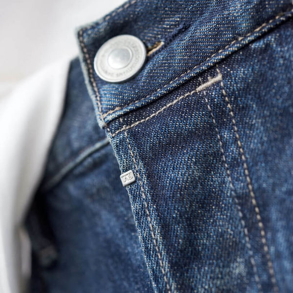 Close up of our AllSaints fly clip under our jeans button.