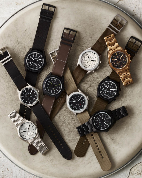 Image of some of our watches set on top of a drum set.