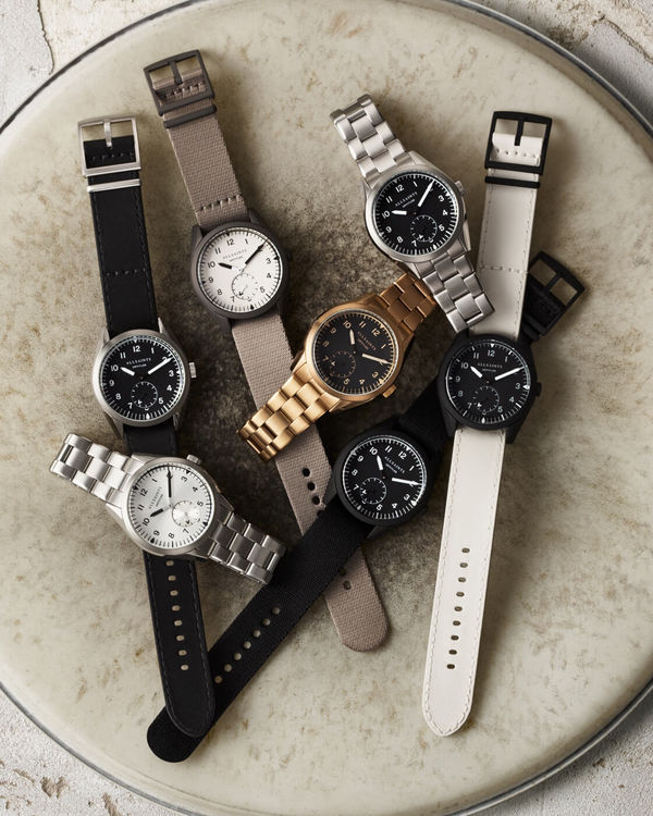 Image of the watches from the Untitled collection set on top of a drum set.