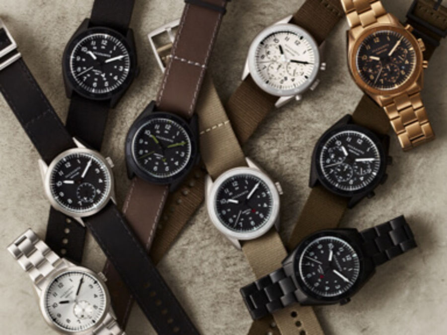 Image of some of our new watches set on a the top of a drum.