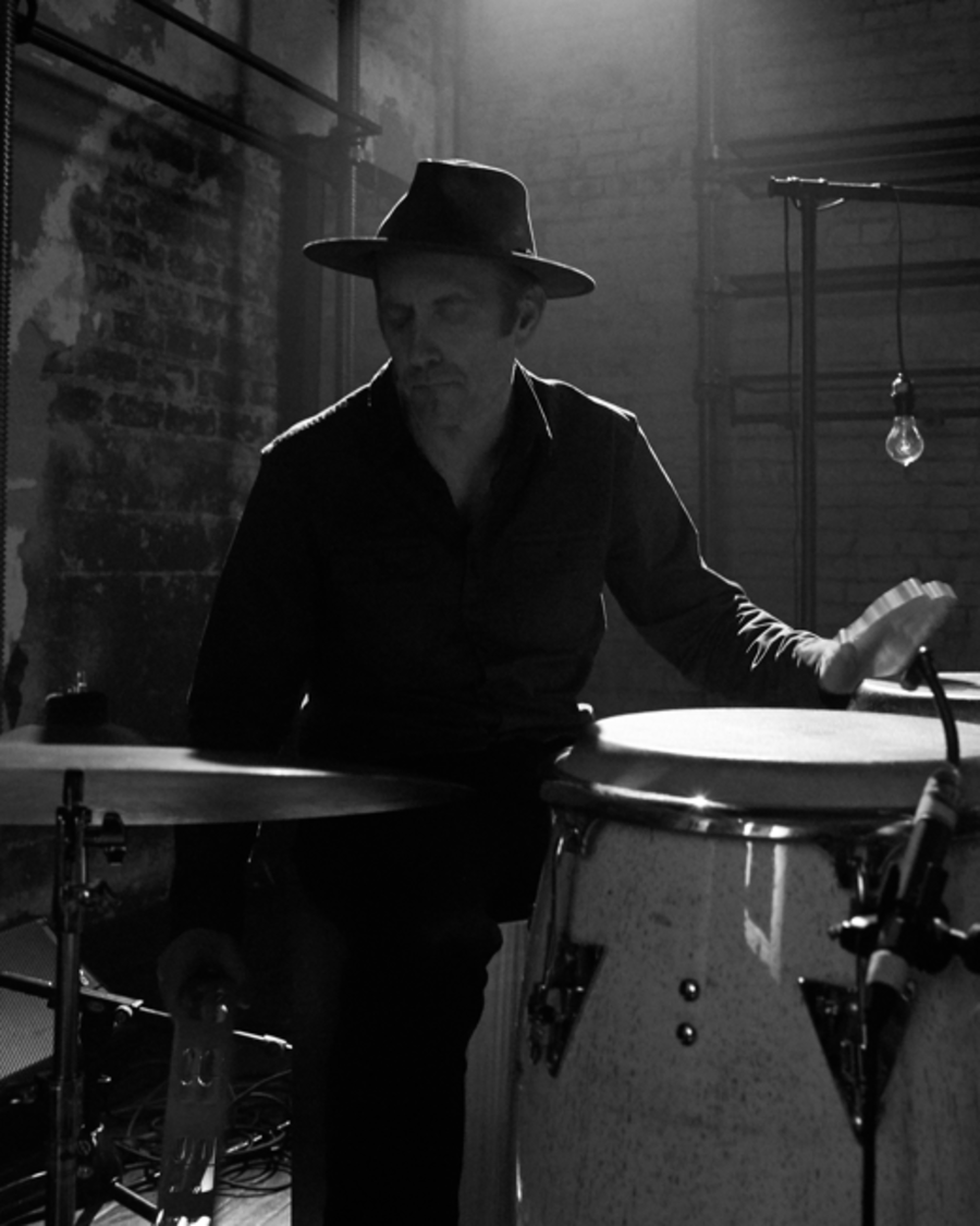 Portrait of Shawn James' drummer wearing a black shirt and fedora during the recording of our latest LA Sessions.