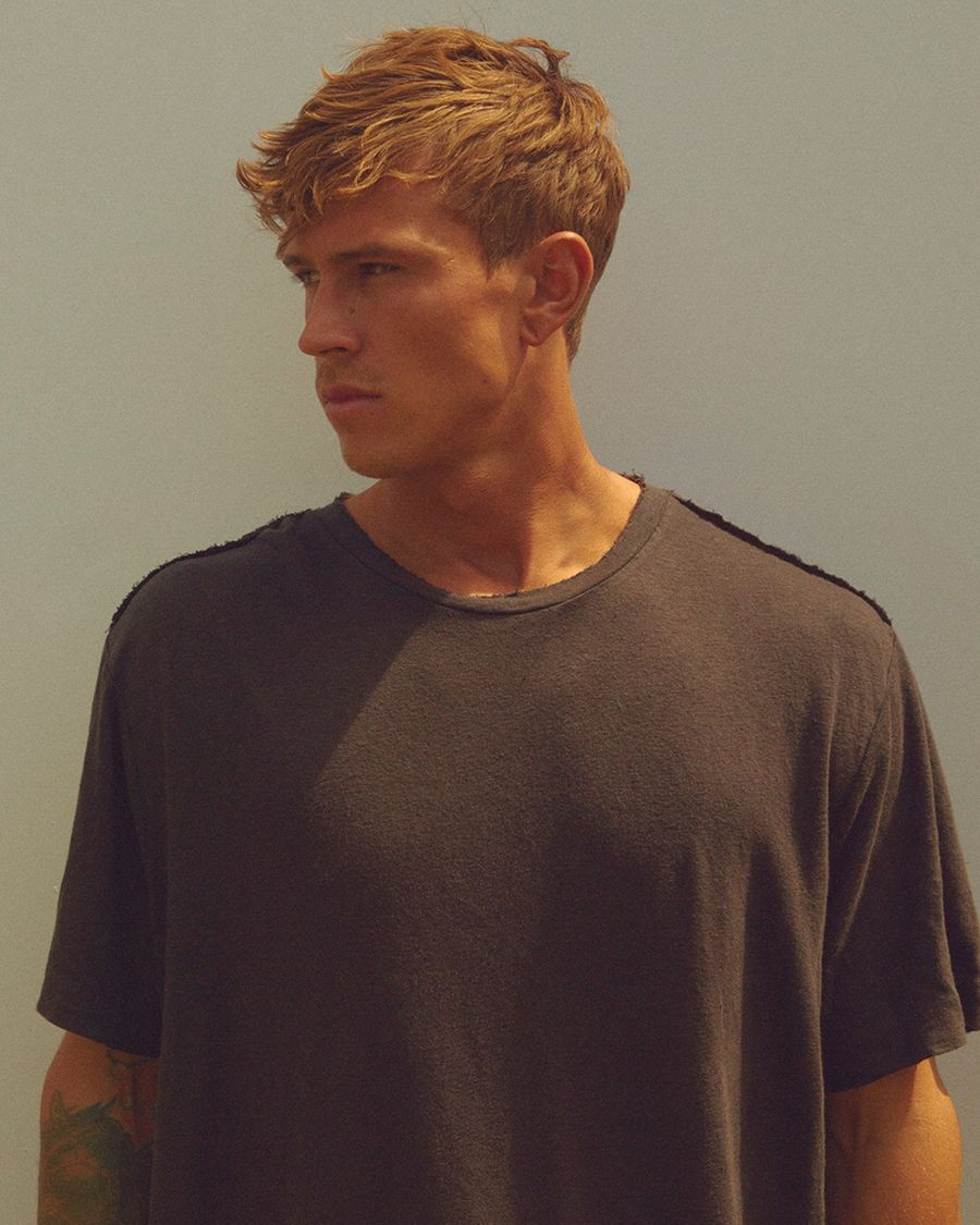 Portrait of a man wearing a washed black t-shirt.