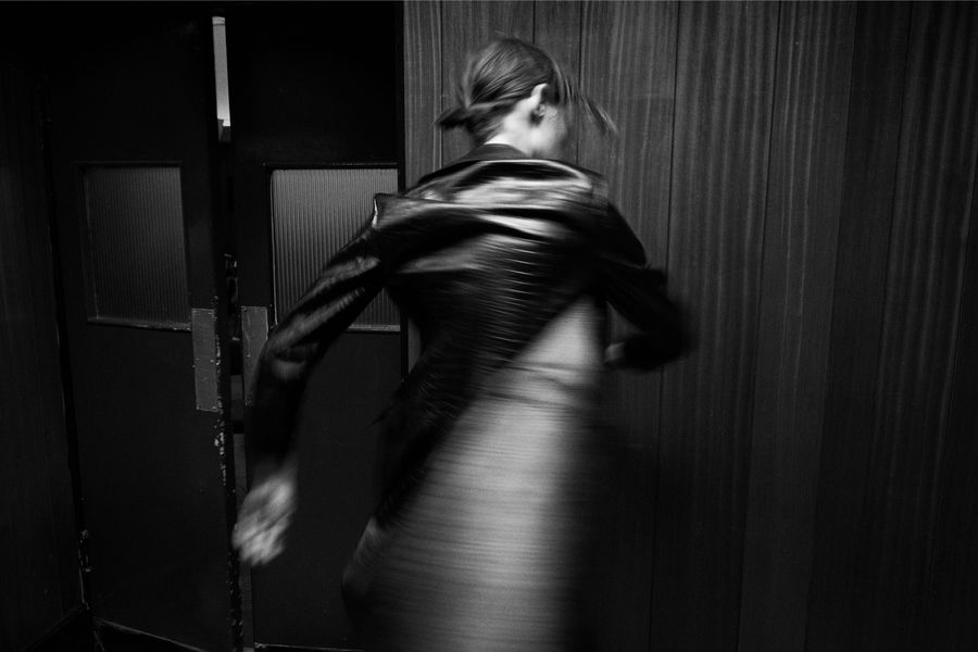 Black and white image of a woman twirling wearing our latest collection.