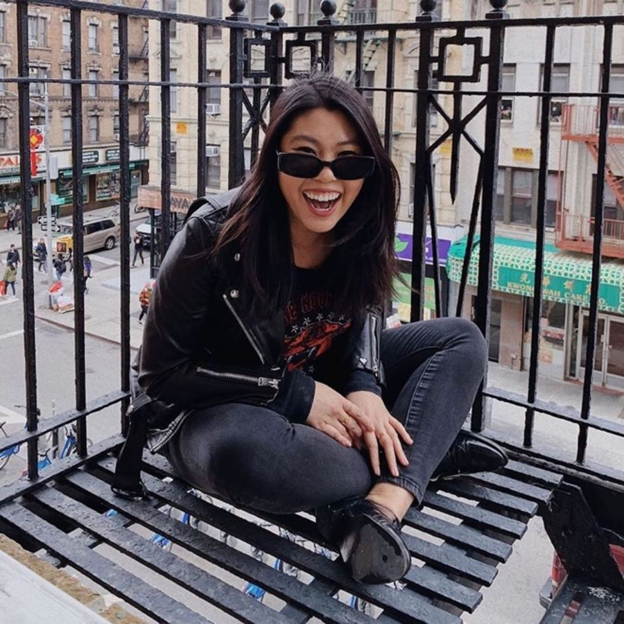 Image of a woman sitting in a street wearing a leather jacket.
