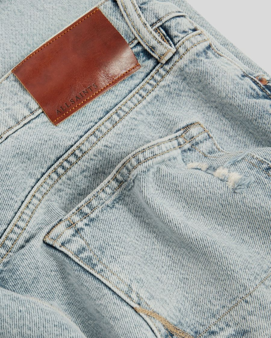 Close up on the back pocket of our light blue tapered leg jeans.