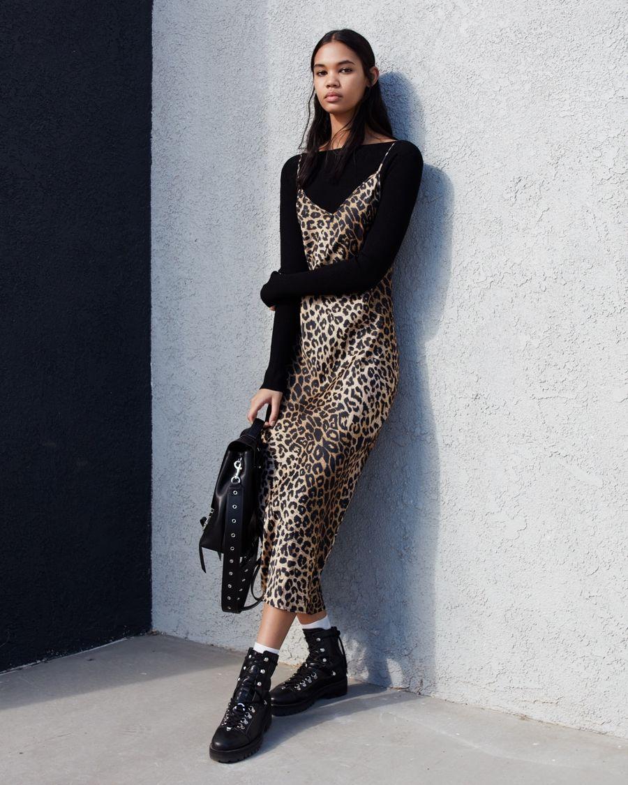 0b64307e967 Image of a woman wearing a thin strap long leopard print dress over a black  long