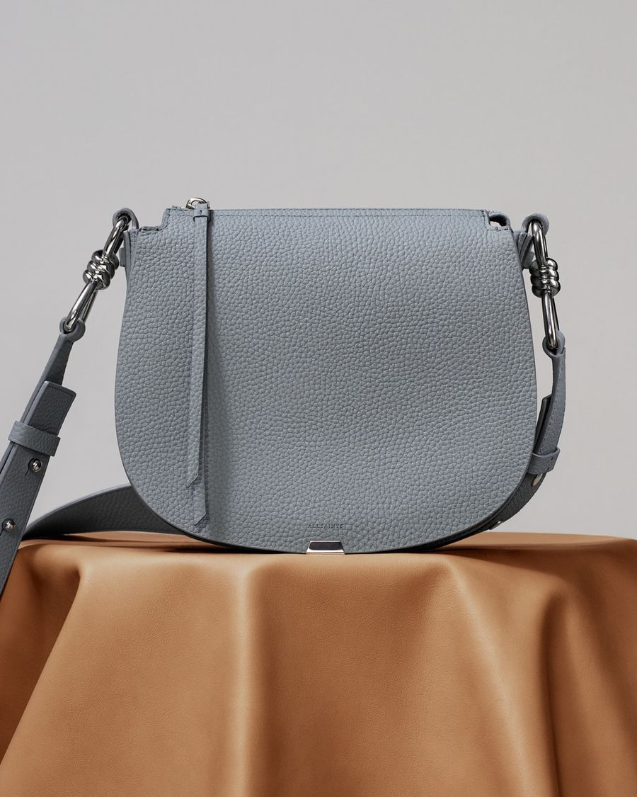 Image of our light denim blue, pebbled leather crossbody bag.