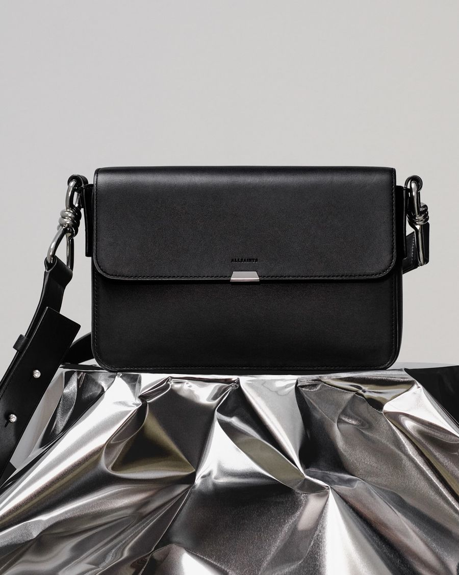 Image of our black leather Captain crossbody bag.