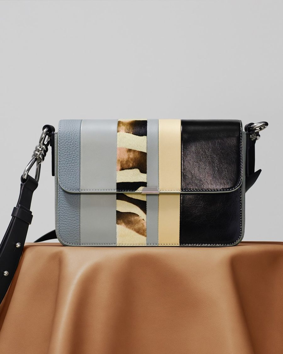 Image of our multi-coloured striped Capatain Leather Crossbody Bag.