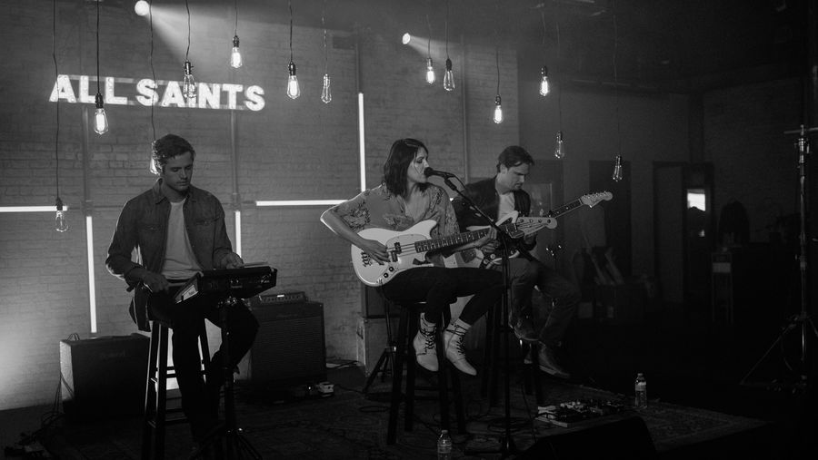 Black and white picture of K. Flay and her band playing during our latest La sessions recording and wearing items from our women's and men's collections.